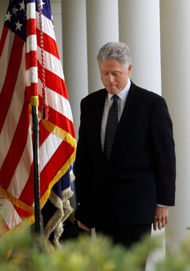 US President Bill Clinton walks past columns encircling the Rose Garden after making a statement regarding the impeachment trial, February 12. Clinton was acquitted on both charges against him. ??ª - PBEAHULWREG