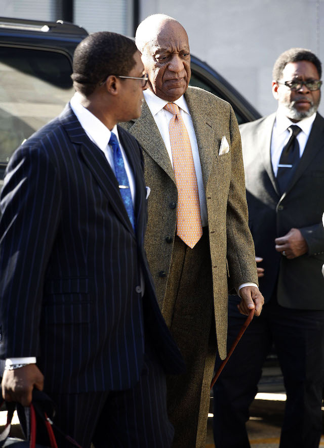 Bill Cosby arrives at court with spokesperson Andrew Wyatton on the first day of jury deliberations as he is retried on charges of Sexual Assault on April 23 2018 at the Montgomery County Courthouse Pictured: Bill Cosby Picture by: Splash News
