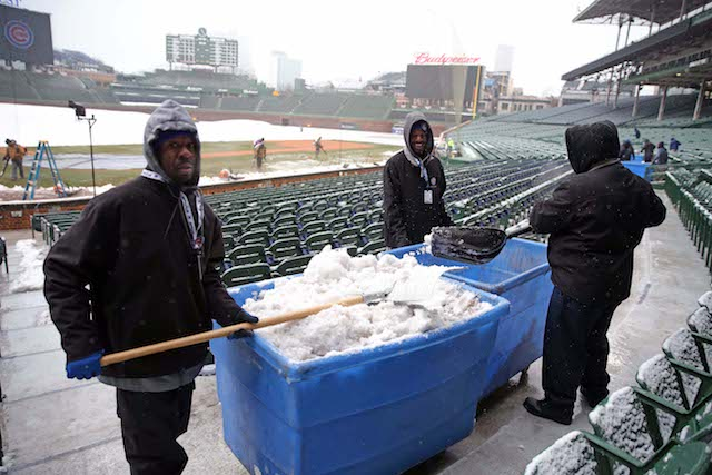 Apr 9, 2018; Chicago, IL, USA; A general shot of workers cleaning snow from Wrigley Field prior to a game between the Chicago Cubs and the Pittsburgh Pirates. Mandatory Credit: Dennis Wierzbicki-USA TODAY Sports - 10778282