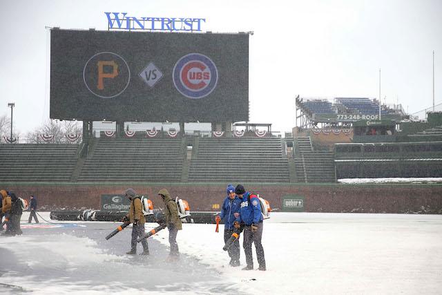 Apr 9, 2018; Chicago, IL, USA; A general shot of the grounds crew at Wrigley Field in the snow prior to a game between the Chicago Cubs and the Pittsburgh Pirates. Mandatory Credit: Dennis Wierzbicki-USA TODAY Sports - 10778280
