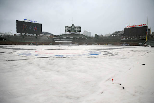 Apr 9, 2018; Chicago, IL, USA; A general shot of Wrigley Field in the snow prior to a game between the Chicago Cubs and the Pittsburgh Pirates. Mandatory Credit: Dennis Wierzbicki-USA TODAY Sports - 10778276