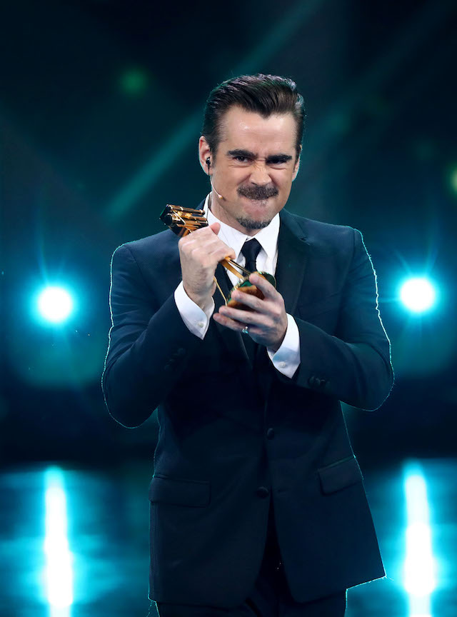 "Irish actor Colin Farrell poses with his ""Best actor International"" award during the awarding ceremony of the Golden Camera Award in Hamburg, northern Germany, on March 4, 2017. / AFP PHOTO / POOL / Christian Charisius (Photo credit should read CHRISTIAN CHARISIUS/AFP/Getty Images)"