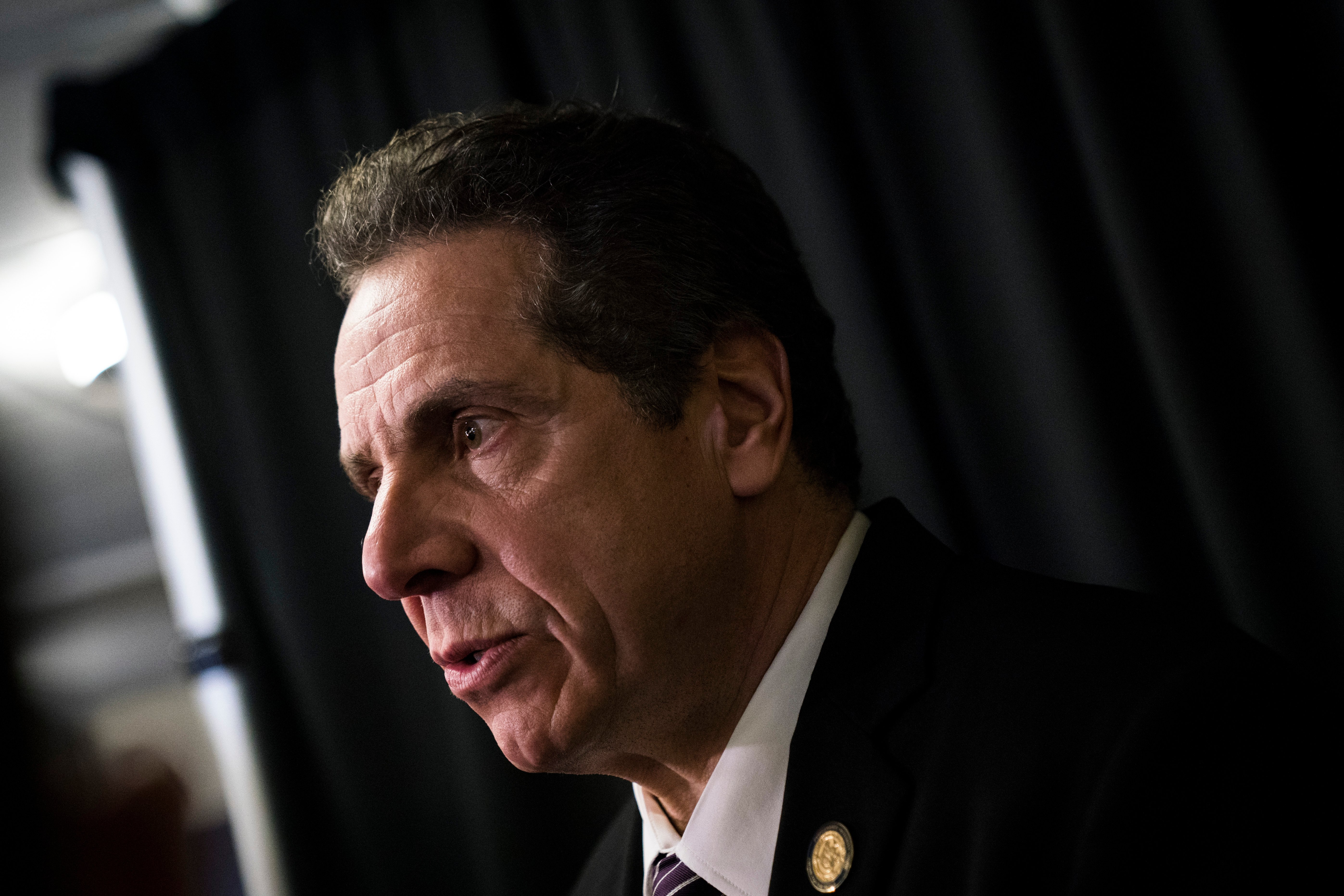 NEW YORK, NY - FEBRUARY 21: New York Governor Andrew Cuomo speaks to reporters after a healthcare union rally at the Theater at Madison Square Garden, February 21, 2018 in New York City. The rally was organized by 1199SEIU United Healthcare Workers East, the largest healthcare union in the United States. (Photo by Drew Angerer/Getty Images)