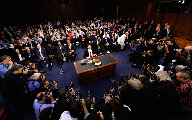 "FILE PHOTO: Former FBI Director James Comey prepares to testify before a Senate Intelligence Committee hearing on ""Russian Federation Efforts to Interfere in the 2016 U.S. Elections"" on Capitol Hill in Washington, June 8, 2017. REUTERS/Jim Bourg/File Photo"