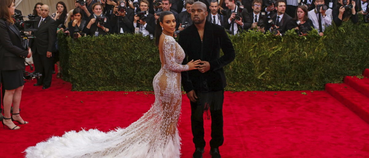 "TV personality Kim Kardashian and rapper Kanye West arrive at the Metropolitan Museum of Art Costume Institute Gala 2015 celebrating the opening of ""China: Through the Looking Glass,"" in Manhattan, New York May 4, 2015. REUTERS/Lucas Jackson"