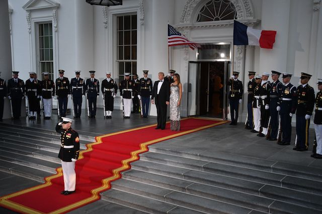 US President Donald Trump and First Lady Melania Trump wait for French President Emmanuel Macron and his wife Brigitte before a State Dinner at the North Portico of the White House in Washington, DC, April 24, 2018. (Photo by JIM WATSON / AFP) (Photo credit should read JIM WATSON/AFP/Getty Images)