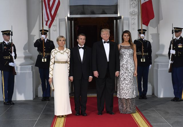 US President Donald Trump and First Lady Melania Trump welcome French President Emmanuel Macron and his wife, Brigitte Macron, as they arrive for a State Dinner at the North Portico of the White House in Washington, DC, April 24, 2018. (Photo by SAUL LOEB / AFP) (Photo credit should read SAUL LOEB/AFP/Getty Images)