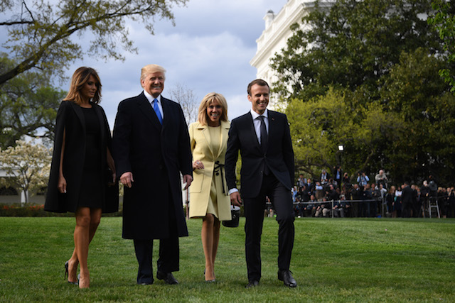 US President Donald Trump and First Lady Melania Trump, and French President Emmanuel Macron and his wife, Brigitte Macron walk outside the White House April 23, 2018 in Washington,DC. (Photo by JIM WATSON / AFP) (Photo credit should read JIM WATSON/AFP/Getty Images)