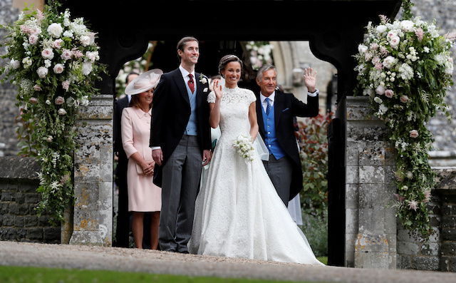 FILE PHOTO: David Matthews (right) waves to well-wishers at the wedding of his son James Matthews and Pippa Middleton at St Mark's Church in Englefield, Britain, May 20, 2017. REUTERS/Kirsty Wigglesworth/Pool/File Photo - RC1FC0A907D0