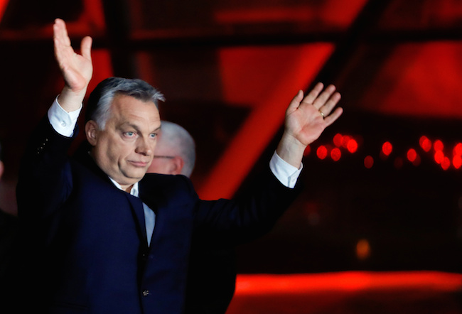 Hungarian Prime Minister Viktor Orban addresses the supporters after the announcement of the partial results of parliamentary election in Budapest, Hungary, April 8, 2018. REUTERS/Leonhard Foeger