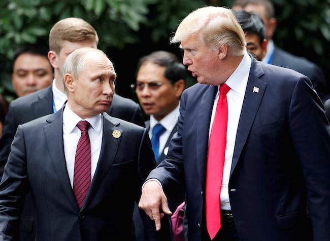 President Donald Trump and Russia's President Vladimir Putin talk during the family photo session at the APEC Summit in Danang, Vietnam, November 11, 2017. REUTERS/Jorge Silva/File Photo