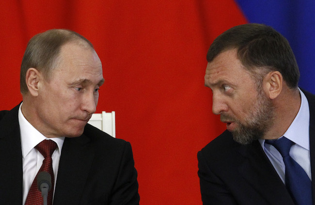Russia's President Vladimir Putin and Russian tycoon Oleg Deripaska attend a signing ceremony after talks with the Chinese delegation at the Kremlin in Moscow March 22, 2013. REUTERS/Sergei Karpukhin
