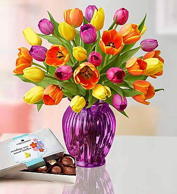 Normally $72, this tulip arrangement with a vase and chocolates is 15 percent off with the code DAILYCALLER (Photo via 1800flowers.com)