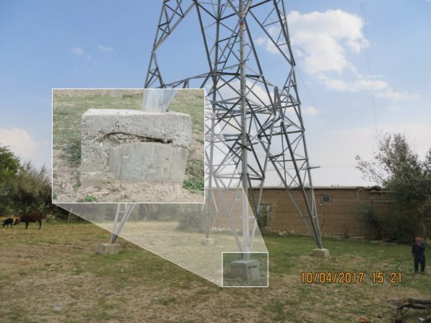 A cracked foundation supports one of the towers Afghanistan's currently inoperable new electrical system (SIGAR)