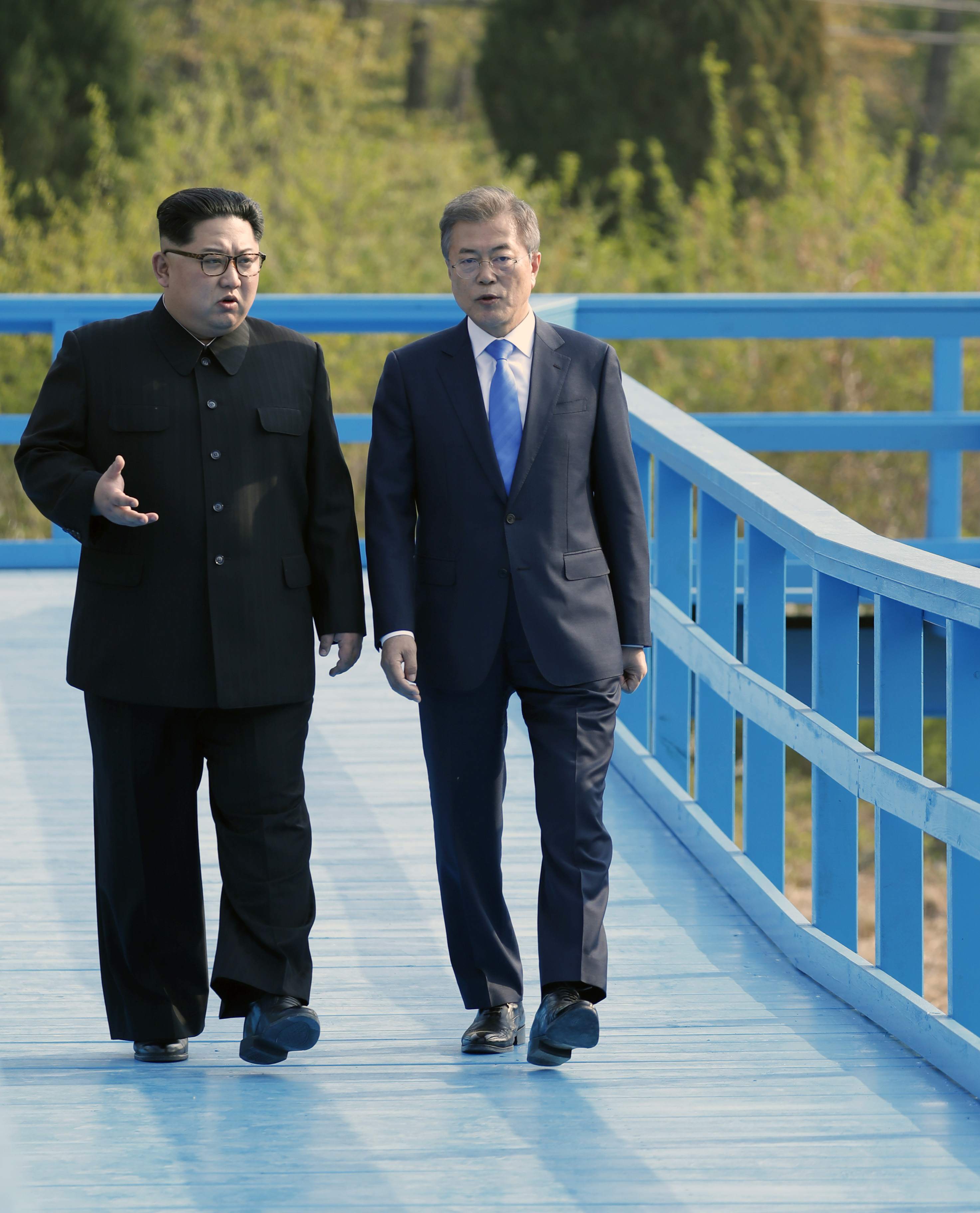 PANMUNJOM, SOUTH KOREA - APRIL 27: North Korean leader Kim Jong Un (L) and South Korean President Moon Jae-in (R) take a walk on the walk bridge during the Inter-Korean Summit on April 27, 2018 in Panmunjom, South Korea. Kim and Moon meet at the border today for the third-ever Inter-Korean summit talks after the 1945 division of the peninsula, and first since 2007 between then President Roh Moo-hyun of South Korea and Leader Kim Jong-il of North Korea. (Photo by Korea Summit Press Pool/Getty Images)