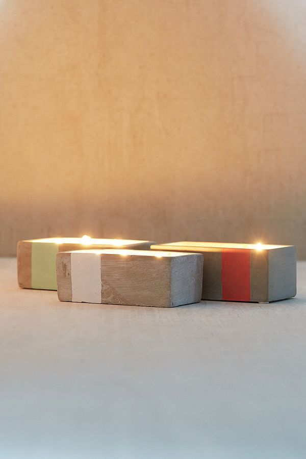 Normally $24, these concrete candles are 33 percent off (Photo via Urban Outfitters)