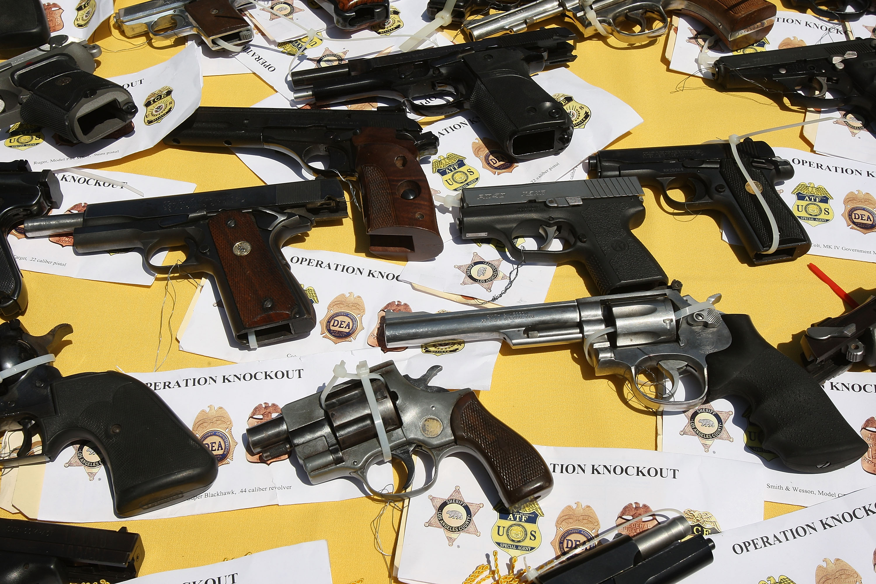 LAKEWOOD, CA - MAY 21: Some of about 125 weapons confiscated during what the federal authorities say is the largest gang takedown in United States history are displayed at a press conference to announce the arrests of scores of alleged gang members and associates on federal racketeering and drug-trafficking charges on May 21, 2009 in the Los Angeles-area community of Lakewood, California. (Photo by David McNew/Getty Images)