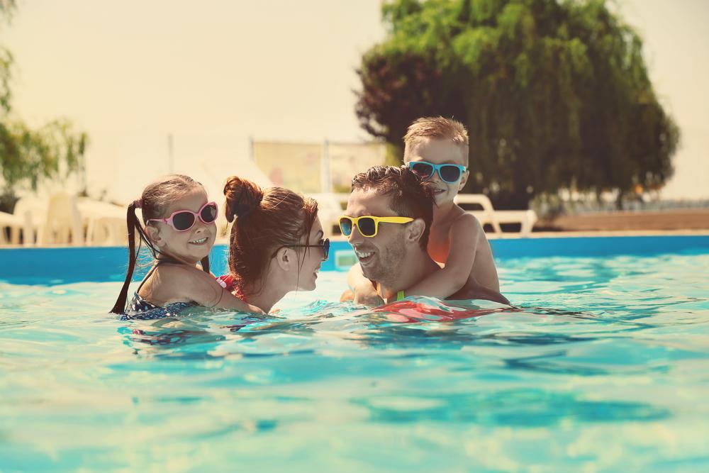 Family swimming (Photo via Shutterstock)