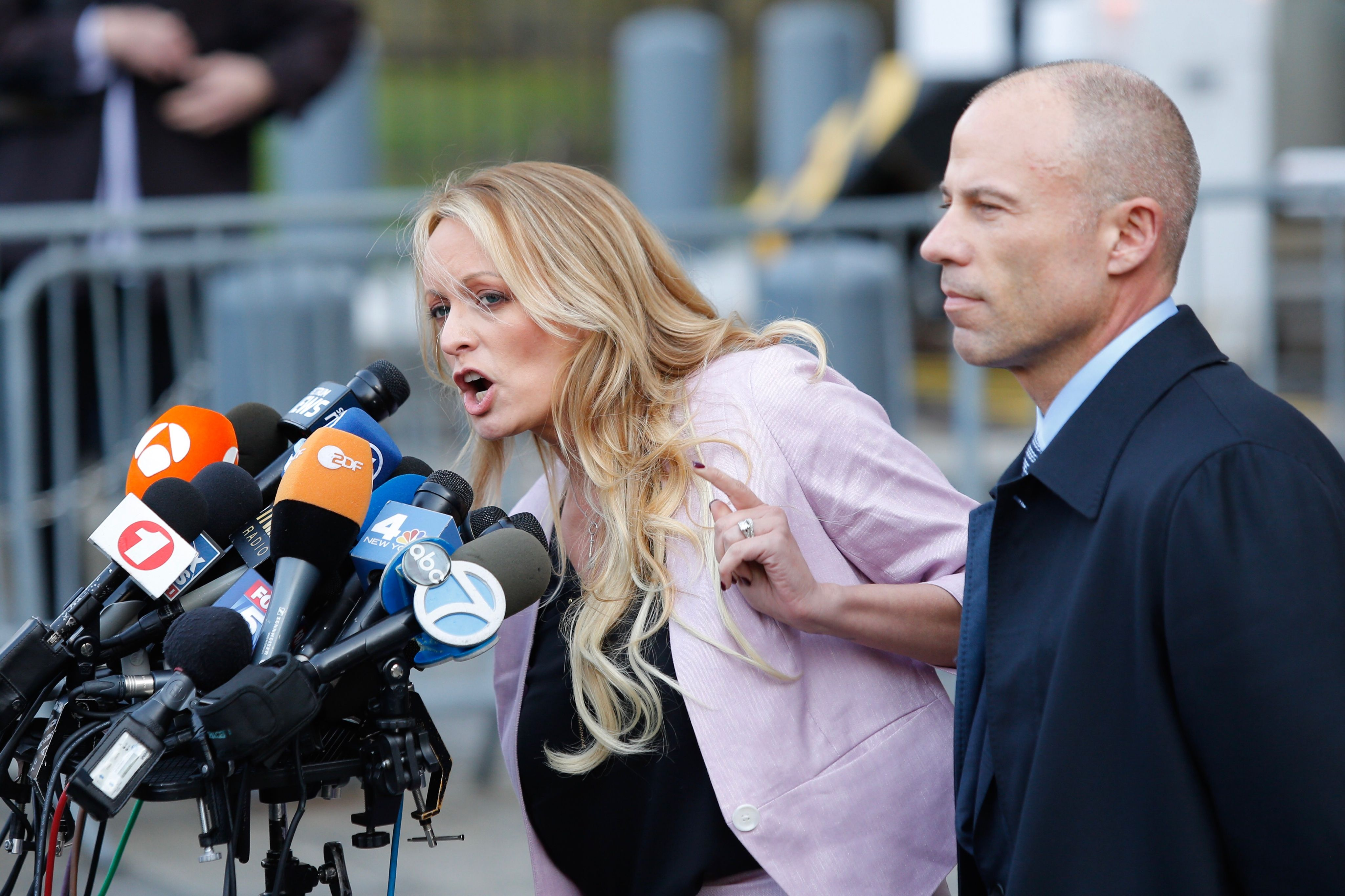 Adult-film actress Stephanie Clifford, also known as Stormy Daniels speaks US Federal Court with her lawyer Michael Avenatti (R) on April 16, 2018, in Lower Manhattan, New York. President Donald Trump's personal lawyer Michael Cohen has been under criminal investigation for months over his business dealings, and FBI agents last week raided his home, hotel room, office, a safety deposit box and seized two cellphones. Some of the documents reportedly relate to payments to porn star Stormy Daniels, who claims a one-night stand with Trump a decade ago, and ex Playboy model Karen McDougal who also claims an affair. (EDUARDO MUNOZ ALVAREZ/AFP/Getty Images)
