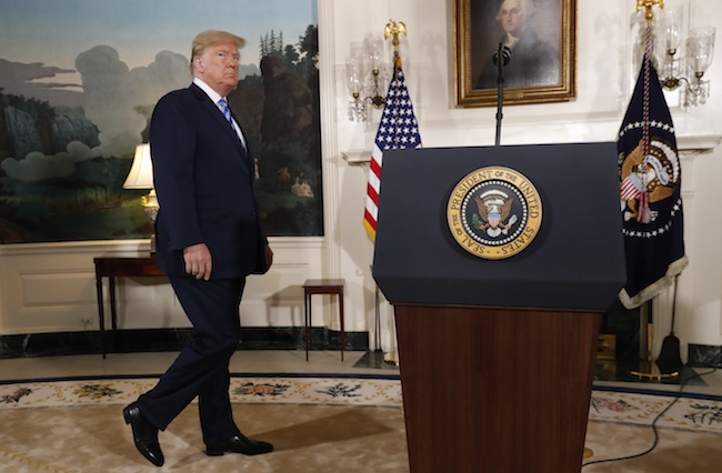 President Donald Trump arrives to announce his decision on the JCPOA Iran nuclear agreement in the Diplomatic Room at the White House in Washington, May 8, 2018. REUTERS/Jonathan Ernst