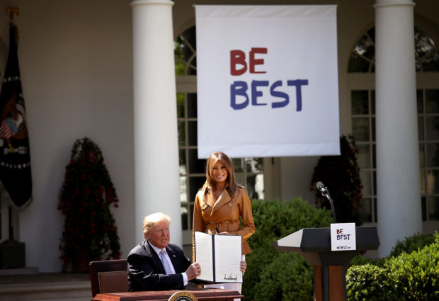 "WASHINGTON, DC - MAY 07: U.S. President Donald Trump holds up a proclamation for ""National Be Best Day"" afer U.S. first lady Melania Trump spoke in the Rose Garden of the White House May 7, 2018 in Washington, DC. Melania Trump outlined her new initiatives, known as the Be Best program, during the event. (Photo by Win McNamee/Getty Images)"