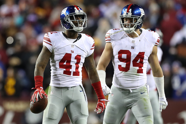 LANDOVER, MD - JANUARY 01: Cornerback Dominique Rodgers-Cromartie #41 of the New York Giants celebrates with teammate outside linebacker Mark Herzlich #94 after intercepting the ball against the Washington Redskins in the fourth quarter at FedExField on January 1, 2017 in Landover, Maryland. (Photo by Rob Carr/Getty Images)