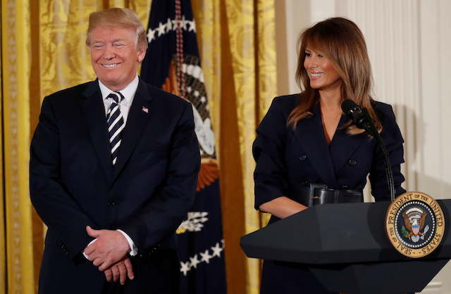 U.S. President Donald Trump and first lady Melania Trump participate in a celebration of military mothers and spouses at the White House in Washington, U.S., May 9, 2018. REUTERS/Leah Millis - RC19050D6760