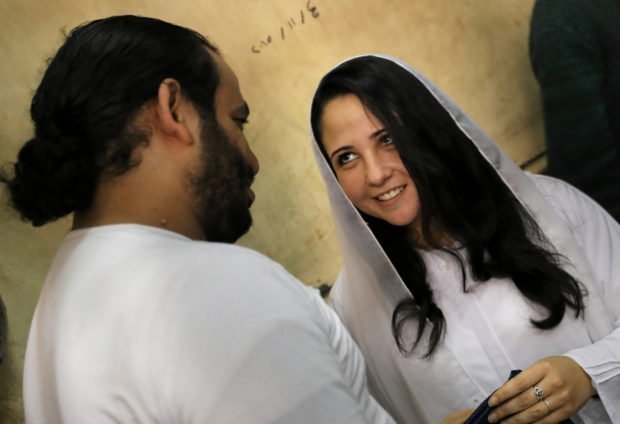 Aya Hijazi and her husband Mohamed Hassanein, founders of Belady, an NGO that promotes a better life for street children, talk inside a holding cell as they face trial on charges of human trafficking at a courthouse in Cairo, Egypt March 23, 2017. Picture taken March 23, 2017. REUTERS/Mohamed Abd El Ghany