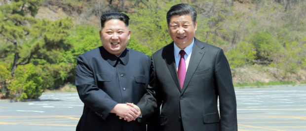 North Korean leader Kim Jong Un shakes hands with China's President Xi Jinping, in Dalian, China in this undated photo released on May 9, 2018 by North Korea's Korean Central News Agency (KCNA). KCNA/via REUTERS