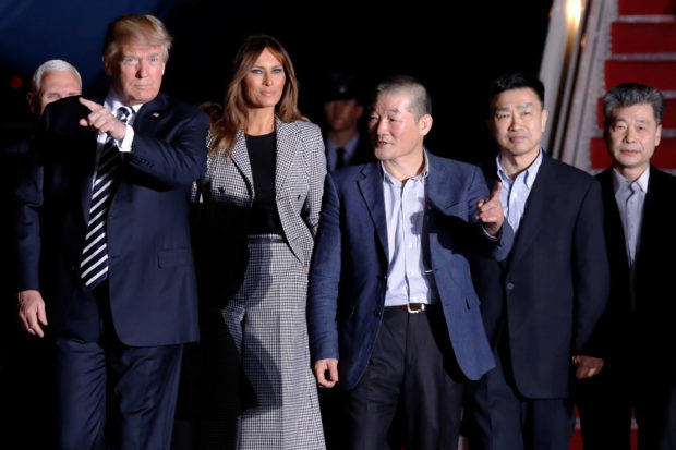 U.S. President Donald Trump and first lady Melania Trump meet the three Americans released from detention in North Korea upon their arrival at Joint Base Andrews, Maryland, U.S. May 10, 2018. REUTERS/Jonathan Ernst