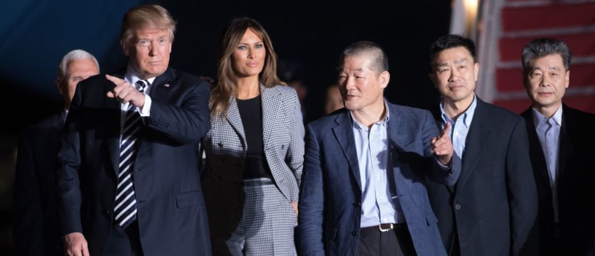 TOPSHOT - US President Donald Trump (L) and wife Melania Trump (2nd L) walk with US detainees Tony Kim (2nd R), Kim Hak-song (R) and Kim Dong-chul (C) upon their return after they were released by North Korea, at Joint Base Andrews in Maryland on May 10, 2018. - US President Donald Trump greeted the three US citizens released by North Korea at the air base near Washington early on May 10, underscoring a much needed diplomatic win and a stepping stone to a historic summit with Kim Jong Un. (Photo by SAUL LOEB / AFP) (Photo credit should read SAUL LOEB/AFP/Getty Images)