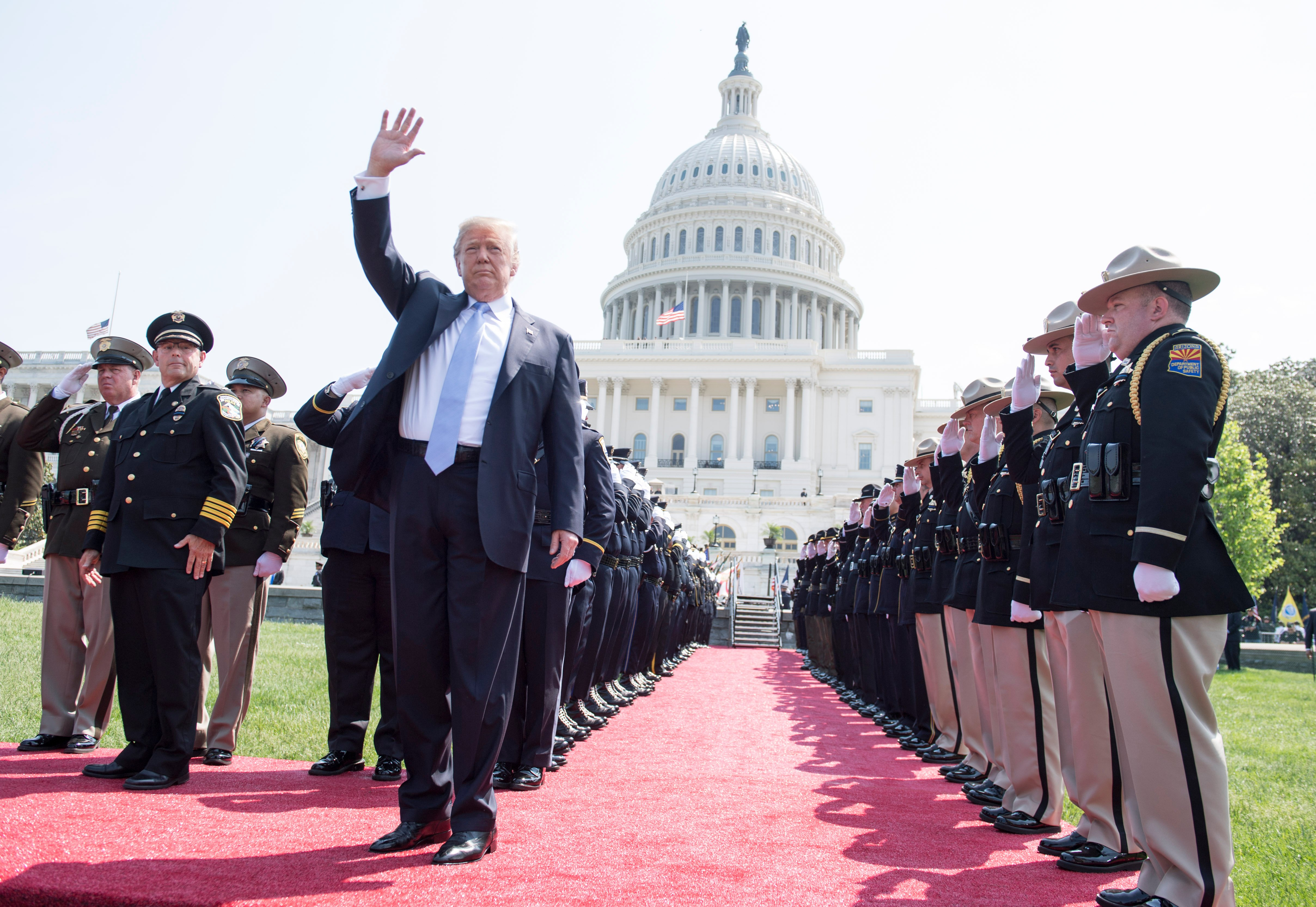 WASHINGTON, DC - MAY 15: US President Donald Trump waves as he arrives at the 37th Annual National Peace Officers' Memorial Service at the U.S. Capitol Building on May 15, 2018 in Washington, D.C. (Photo by Kevin Dietsch-Pool/Getty Images)