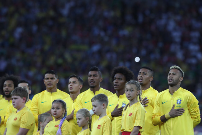 MOSCOW, RUSSIA - JUNE 27: Neymar of Brazil lines up along team mates during the national anthem during the 2018 FIFA World Cup Russia group E match between Serbia and Brazil at Spartak Stadium on June 27, 2018 in Moscow, Russia. (Photo by Michael Steele/Getty Images)