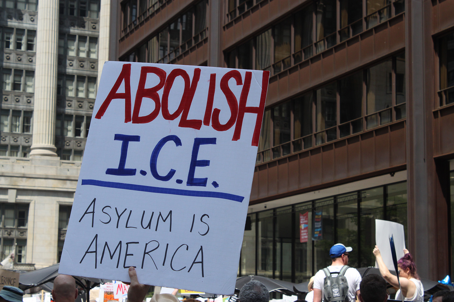 A protester holds up a sign calling for the abolition of Immigration and Customs Enforcement at a demonstration in Chicago on June 30, 2018. Will Racke/TheDCNF