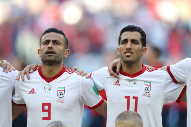 SAINT PETERSBURG, RUSSIA - JUNE 15: Omid Ebrahimi (L) and Vahid Amiri of Iran are seen during national anthem prior to the 2018 FIFA World Cup Russia group B match between Morocco and Iran at Saint Petersburg Stadium on June 15, 2018 in Saint Petersburg, Russia. (Photo by Richard Heathcote/Getty Images)