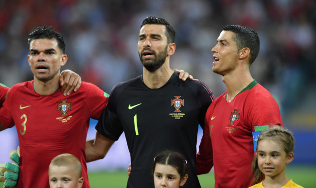 SOCHI, RUSSIA - JUNE 15: Portugal player Christiano Ronaldo (r) looks on during the singing of the national anthem during the 2018 FIFA World Cup Russia group B match between Portugal and Spain at Fisht Stadium on June 15, 2018 in Sochi, Russia. (Photo by Stu Forster/Getty Images)
