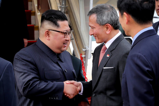 North Korea's leader Kim Jong Un shakes hands with Singapore's Foreign Minister Vivian Balakrishnan after arriving in Singapore June 10, 2018. Singapore's Ministry of Communications and Information/Handout via REUTERS