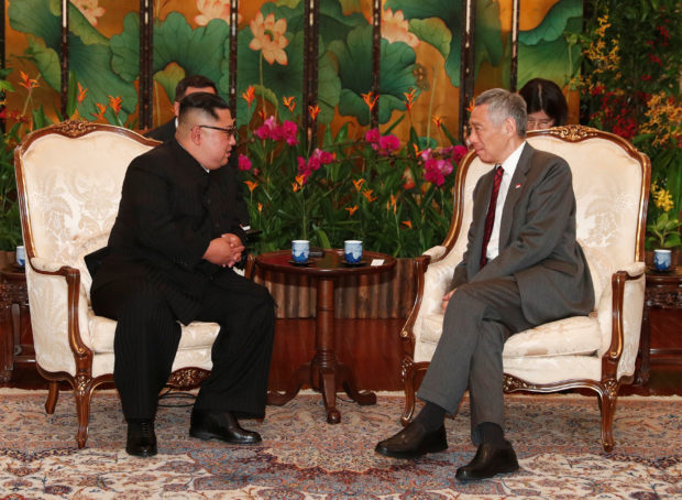 North Korea's leader Kim Jong Un meets with Singapore's Prime Minister Lee Hsien Loong at the Istana in Singapore June 10, 2018. REUTERS/Edgar Su
