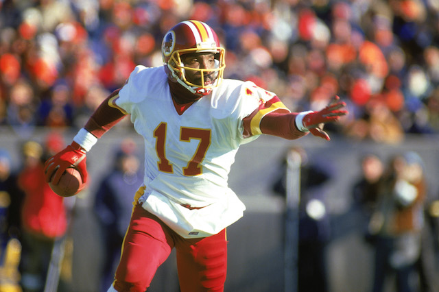 1987: Doug Williams #17 of the Washington Redskins scrambles with the ball during a 1987 NFL season game. (Photo by: Jonathan Daniel/Getty Images) *** Local Caption *** Doug Williams