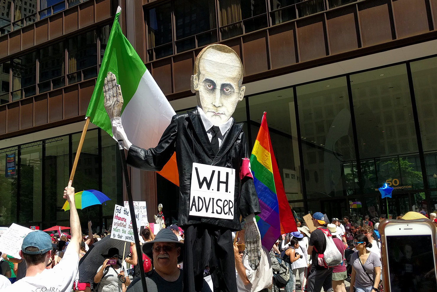 A man holds a sign depicting White House aide Stephen Miller as a Nazi official during a protest in Chicago on June 30, 2018. Will Racke/TheDCNF