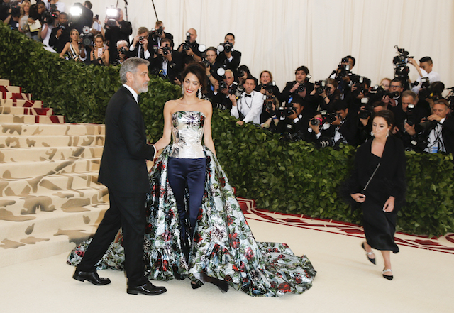 Actor George Clooney and his wife Amal Clooney arrive at the Metropolitan Museum of Art Costume Institute Gala (Met Gala) to celebrate the opening of ìHeavenly Bodies: Fashion and the Catholic Imaginationî in the Manhattan borough of New York, U.S., May 7, 2018. REUTERS/Carlo Allegri