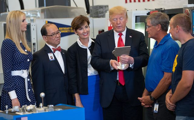 US President Donald Trump tours an advanced manufacturing lab with his daughter, Ivanka Trump (L), at Northeast Iowa Community College in Peosta, Iowa, July 26, 2018. (Photo credit: SAUL LOEB/AFP/Getty Images)