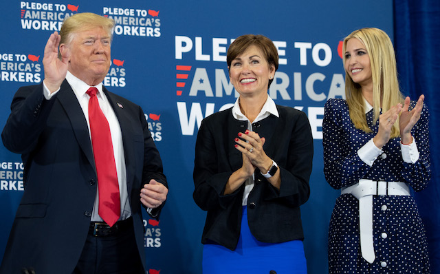 US President Donald Trump speaks, alongside Iowa Governor Kim Reynolds (C) and daughter Ivanka Trump (R), as he holds a roundtable discussion on workforce development at Northeast Iowa Community College in Peosta, Iowa, July 26, 2018. (Photo credit: SAUL LOEB/AFP/Getty Images)