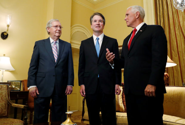 U.S. Senate Majority Leader Mitch McConnell greets Supreme Court nominee Judge Brett Kavanaugh and Vice Preisdent Mike Pence for a meeting in his office at the U.S. Capitol on Capitol Hill in Washington, U.S., July 10, 2018. REUTERS/Leah Millis