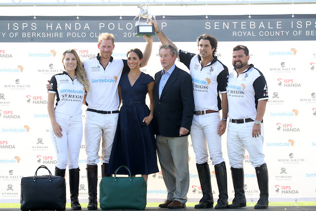 Ashley van Metre Busch, Prince Harry Duke of Sussex, Meghan Duchess of Sussex, Enda Kenny, Nacho Figuares and Miguel Mendoza pose with the Sentebale Polo 2018 trophy after the Sentebale Polo 2018 held at the Royal County of Berkshire Polo Club on July 26, 2018 in Windsor, England. (Photo by Chris Jackson/Getty Images)