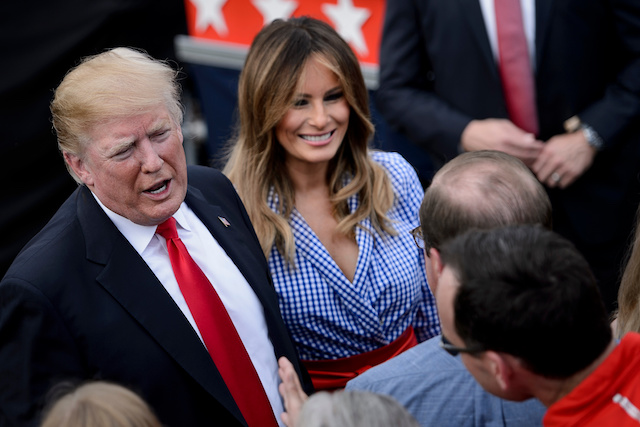 US President Donald Trump (L) and US First Lady Melania Trump greet guests during an Independence Day picnic for military families on the South Lawn of the White House July 4, 2018 in Washington, DC. (Photo credit should read BRENDAN SMIALOWSKI/AFP/Getty Images)