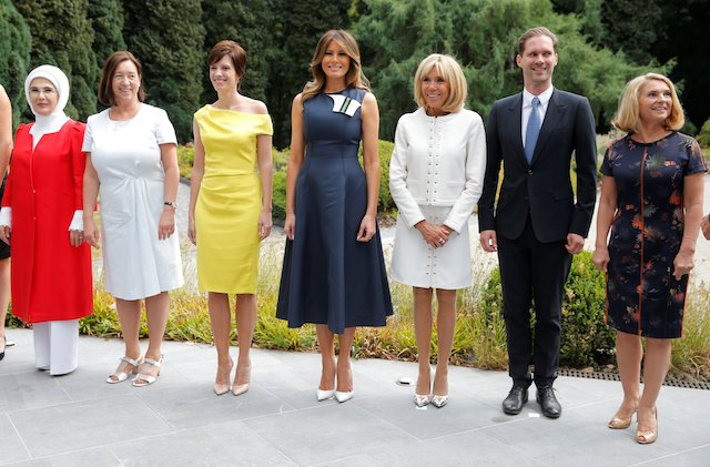 Turkey's first lady Emine Erdogan, U.S. first lady Melania Trump and France's first lady Brigitte Macron, Belgian Prime Minister's partner Amelie Derbaudrenghien, Jens Stoltenberg's spouse Ingrid Schulerud, European Council President Donald Tusk's wife Malgorzata Sochacka, and Luxemburg's Prime Minister Xavier Bettel's husband, Gauthier Destenay, pose for a picture at the Queen Elisabeth Music Chapel in Waterloo, Belgium July 11, 2018. REUTERS/Vincent Kessler