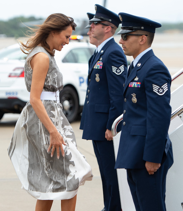 Melania Turns Heads In Grey Floral Dress Ahead Of Her Trip