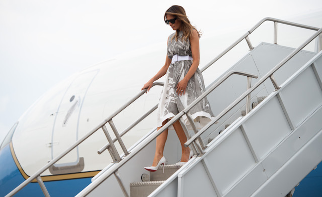 "US First Lady Melania Trump disembarks from a military airplane after arriving at Nashville International Airport in Nashville, Tennessee on July 24, 2018, as she travels to visit a children's hospital as part of her ""Be Best"" campaign. (Photo credit: SAUL LOEB/AFP/Getty Images)"