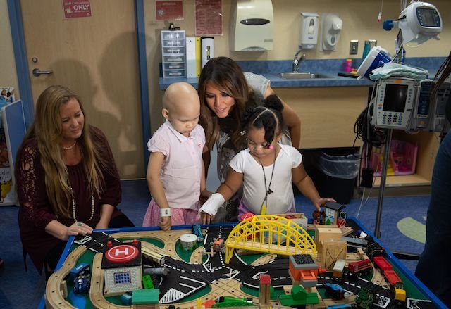 "US First Lady Melania Trump plays with patients Essence Overton (2nd-L), 4 years old, and Natalayah Fields (R), 3 years old, following a roundtable discussion on neonatal abstinence syndrome (NAS) during a visit to Monroe Carell Jr. Children's Hospital at Vanderbilt in Nashville, Tennessee, July 24, 2018, as part of her ""Be Best"" campaign. (Photo credit: LOEB/AFP/Getty Images)"